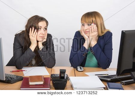 Two Office Workers Tired Tortured Look At Each Other