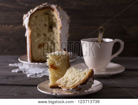 Traditional easter cake kulich on the wooden table in rustic style