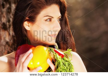 Cut photo an attractive young woman with lots of vegetables - landscape