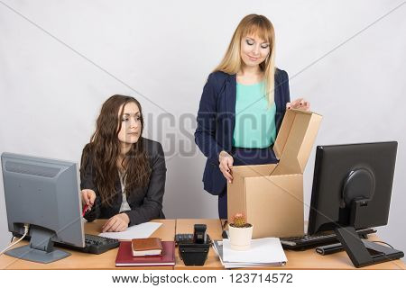 An Employee In The Office Watching A New Colleague Who Arranges Things