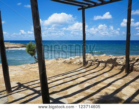 Old Wooden Canopy On The Sea Coast And Blue Sky