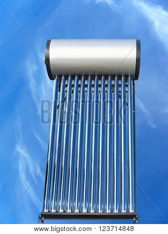 tubes of solar water heater over blue sky background