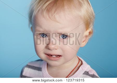 photo of little cute child with tears on face