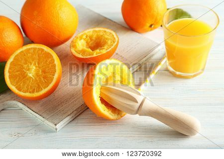 Citrus Fruits With Juicer On A Blue Wooden Table
