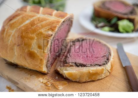 Slices of Beef Wellington on the serving dish ** Note: Shallow depth of field