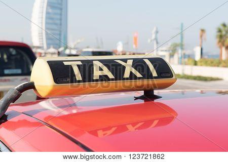 DUBAI UAE - JAN 12: Taxi in Dubai waiting for customers. Jan 12 2015 in Dubai United Arab Emirates Jumeirah beach area
