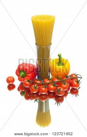 spaghetti cherry tomatoes and peppers on a white background with reflection. vertical photo