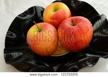 old record formed into a bowl of fruit - three apples