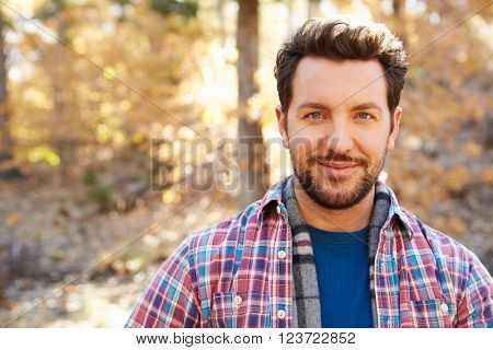 Head And Shoulders Portrait Of Man In Autumn Woodland