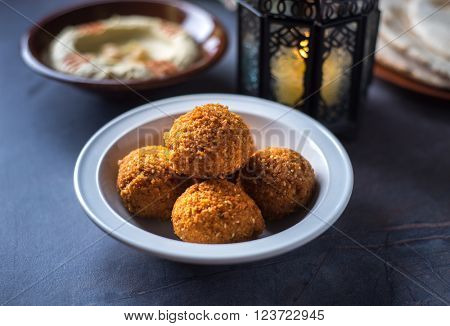 Bowl of fresh Falafel with hummus and Ramadan lamp. Ramadan special food.