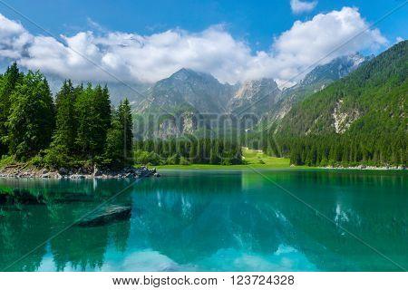 alpine lake Di Laghi Fusine . Dolomites alps . Italy