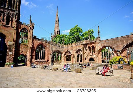 COVENTRY, UK - JUNE 4, 2015 - View inside the old Cathedral ruin with the Holy Trinity Church spire to the rear Coventry West Midlands England UK Western Europe, June 4, 2015.