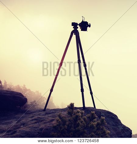 Basalt Tripod With Professional Camera On The Peak Ready For Photography. Sandstone Peaks Increased