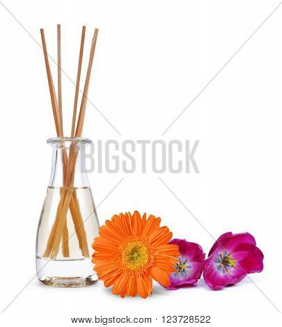 Air freshener with wooden aroma sticks and flowers isolated on white background