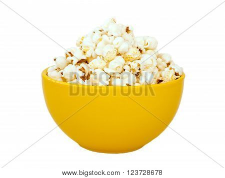 Popcorn in yellow ceramic bowl isolated on white