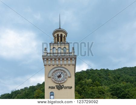 Clock tower - the symbol of the ski complex Rosa Khutor October 7 2015 Krasnodar region Russia. Its shape resembles the clock tower of the Sochi railway station.