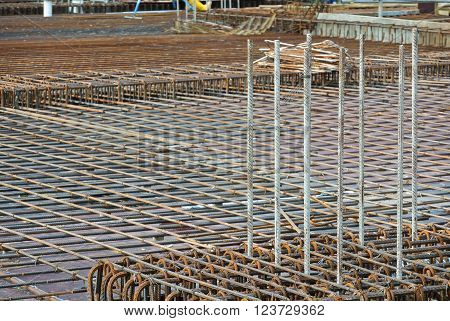 SEPANG, MALAYSIA -MARCH 23, 2016: Floor slab reinforcement bar on timber form work at the construction site in Selangor, Malaysia. The reinforcement bar fabricated by workers.