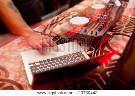 Mixing Console and notebook at the night club.