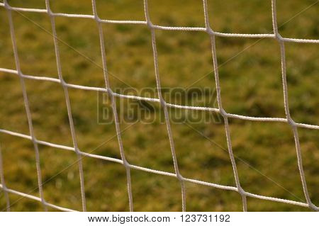 Detail Of Crossed Soccer Nets, Soccer Football In Goal Net With Natural Grass On Football Playground