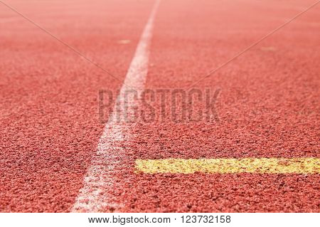 White and yellow lines and texture of running racetrack, red rubber racetracks in outdoor stadium