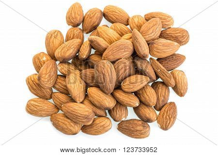 Almonds on a white background. In this photo we see  almonds  on a white background.