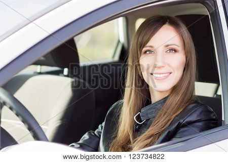 Young Confident Car Driver Woman Steering Wheel.