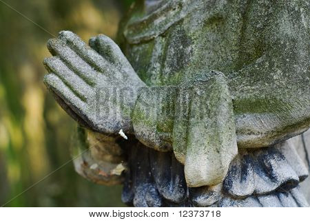 stone hands in a prayer