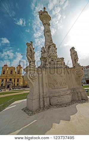 TIMISOARA ROMANIA - MARCH 20 2016: Holy Trinity Statue and German Dome located on Union Square in Timisoara Romania. Fish eye view.