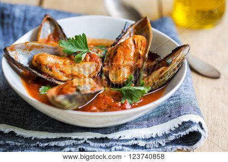 Nezealand Mussels in Tomato and herbs sauce ** Note: Shallow depth of field