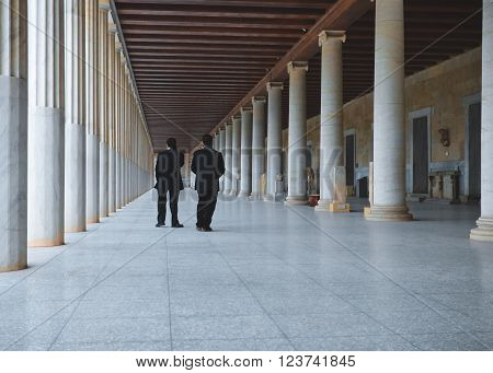Athens, Greece - January 07,2015. Two men at long hall at the entrance of the Museum   Ancient Agora, Athens, Greece.