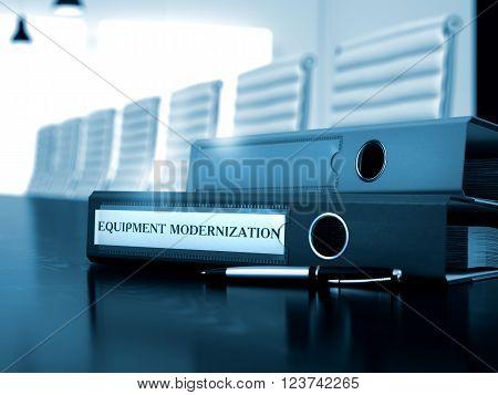 Equipment Modernization - File Folder on Working Desk. Ring Binder with Inscription Equipment Modernization on Office Black Desk. Toned Image. 3D.