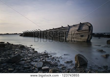 a shipwreck in shallow water and the sunset ** Note: Soft Focus at 100%, best at smaller sizes