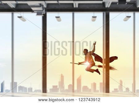 Man fly besom in office