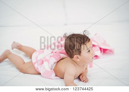 Cute baby lying on front at home