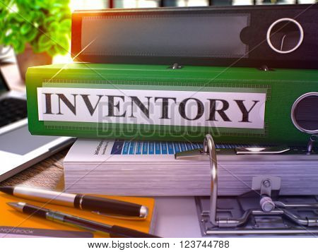 Green Office Folder with Inscription Inventory on Office Desktop with Office Supplies and Modern Laptop. Inventory Business Concept on Blurred Background. Inventory - Toned Image. 3D.