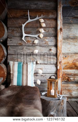 Porch decoration with lantern and reindeer antler