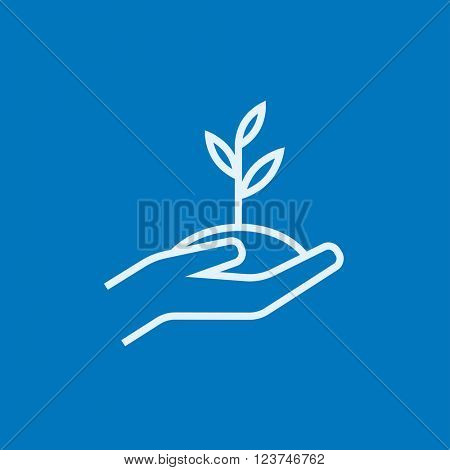 Hands holding seedling in soil line icon.