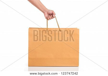 Close Up Hand Holding Brown Paper Bag Isolated On White