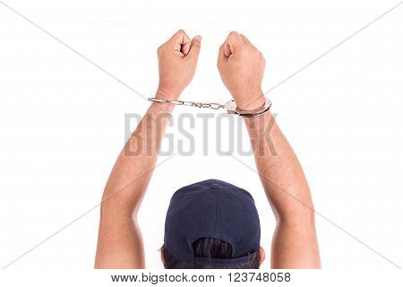 Close Up Hands With Silver Handcuffs Isolated On White