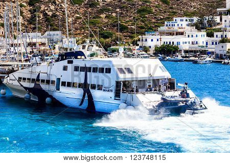IOS, GREECE-OCTOBER 01, 2015: Ferry port of the typical Greek Cyclades white village