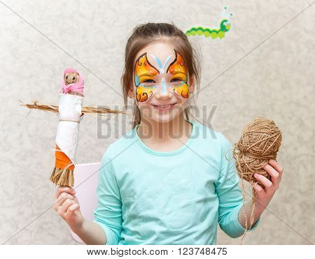 Smiling Girl With Art Make-up Holding Her Handmade Puppet And Skein Of Rope