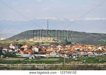 Wide angle view on a poor macedonian village with many houses