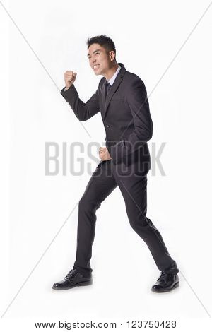 Portrait: Isolated successful young smart businessman cheering and happy