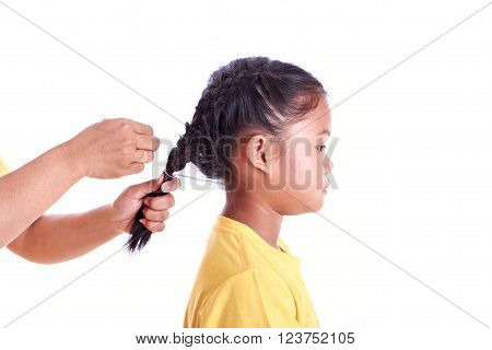 Portrait Of Young Asian Girl While Braiding Hair Isolated On White