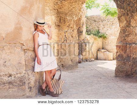 Woman traveler at ancient ruins at Carthage Tunisia