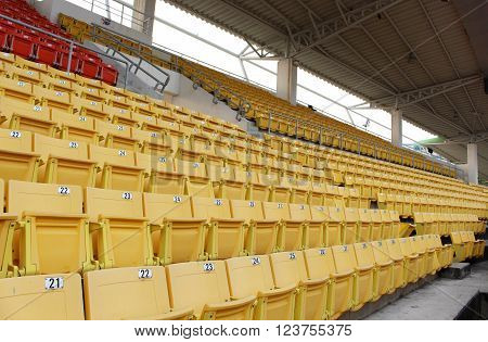 Yellow seats on the grandstand in the stadium.