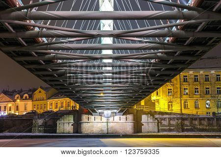 Bernatka footbridge over Vistula river in the night in Krakow Poland