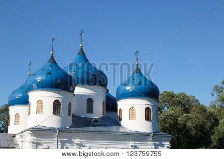 Dome St. George's monastery in Veliky Novgorod, orthodox Christian Church. The Orthodox religion of Russia. Monastery's oldest Church buildings in Russia in 1030 year. White Church with blue domes.