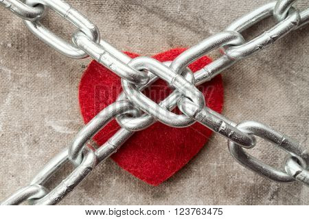 Heart tied with chains. Concept for endless love.