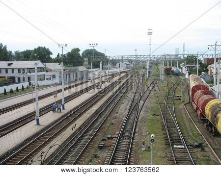 Ukrainian railway station with freight trains on the tracks.